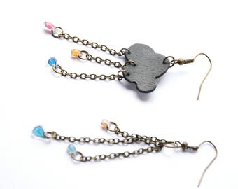 """Head in clouds"" asymmetric earrings made of recycled inner tube rubber"