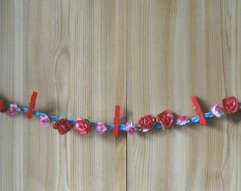 Garland hangs red and pink flowers photo