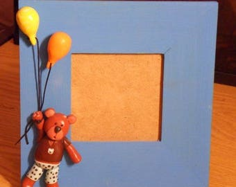 Wooden frame and his teddy bear with balloons