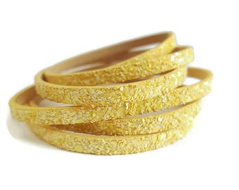 Sparkly gold leather thong and sequin