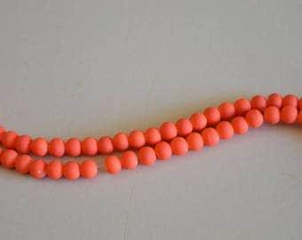 Set of 10 orange synthetic beads