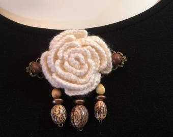 """Brooch crocheted on stamp """"Specks of Earth"""""""
