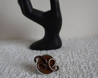 Brown and silver ring