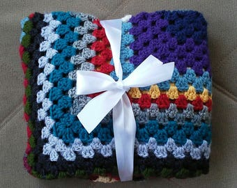 Granny square crocheted multi colored blanket
