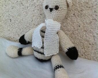 Crocheted ecru and black cat