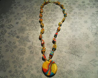 pendant necklace trend, original and colorful (turquoise, yellow and red)