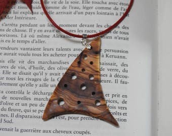 Hand made carved olive wood pendant.