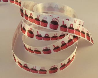 Pattern cup cake on white satin ribbon