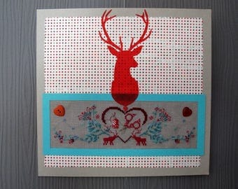 Embroidered deer with a heart picture