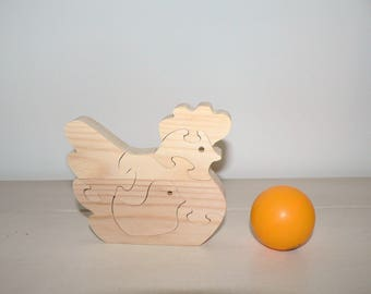 Puzzle hen and her chick in woodcut.