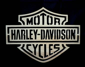 Harley Motor Cycles logo in woodcut