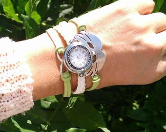 A very nice wristwatch green and white and silver charms