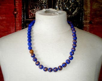 Beaded necklace asymmetrical geometric pattern
