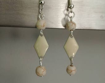 Diamond and Pearl ivory earrings.