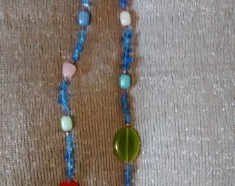 Long necklace in glass and gemstones