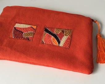 Orange small linen clutch with tassel
