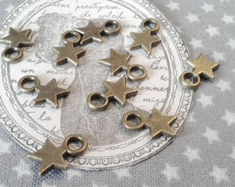Star charms / 20 x / bronze / 11 x 8 mm