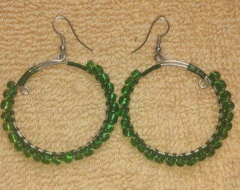 green & silver colored wire wrapped hoop earrings