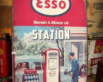 metal deco cars by Esso gas station sign
