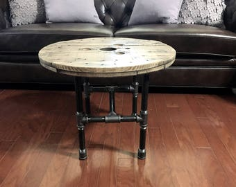 Reclaimed wood spool table. Coffee table. Upcycled rustic table