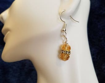 Amber colored and crystal dangle earrings