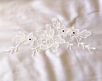 Embroidery on white jersey
