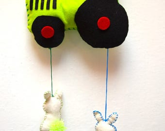 Hanging mobile tractor with bunnies