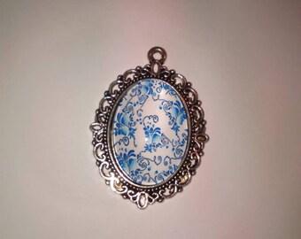 Blue flower cabochon on a white Model 8 pendant