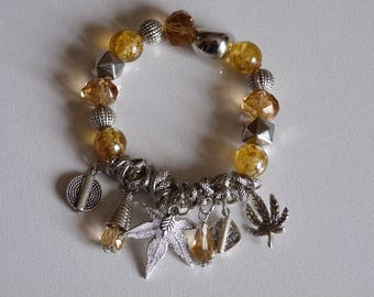GLASS BEADS BRACELET AMBER AND CHARMS
