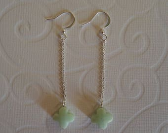 Lime green clover earrings on silver chain.