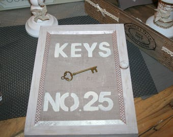 box keys upon white and taupe