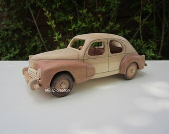 Wooden car of a Peugeot 203 Iroko/Maple 1/24 scale.
