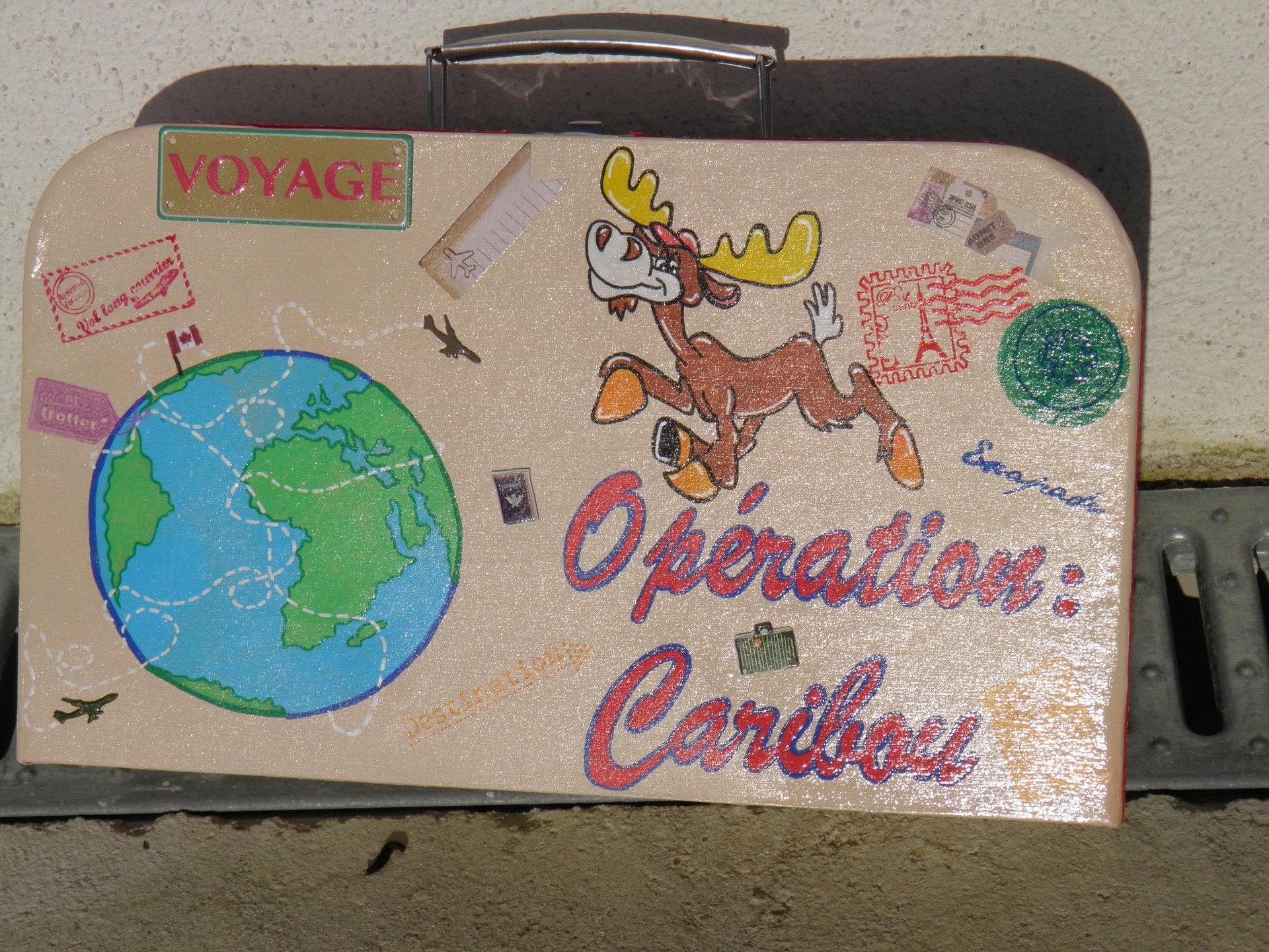 urne anniversaire theme voyage au canada caribou avion. Black Bedroom Furniture Sets. Home Design Ideas