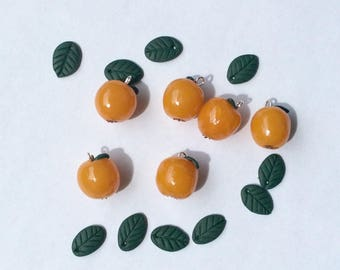 Apples, leaves and yellow beads