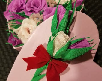 Crepe paper roses in a heart shape box.