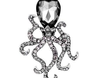 Boche pieuvre métal noir, cristal et strass gris.