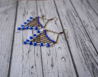 White and blue earrings.