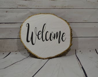 Welcome Sign on Wooden Slice