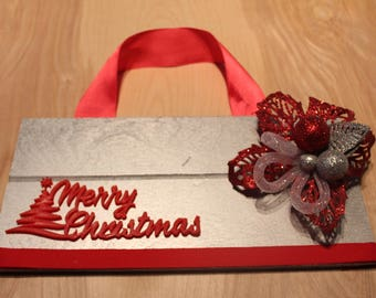 Merry Christmas sign with large bow