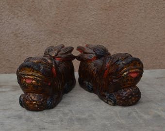"""Vintage Chinese pair of identical carved wooden Foo dogs, painted and gilded.   6"""" long, 2.5"""" at their widest point, 3.5"""" tall"""