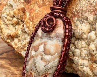 Crazy Lace  Agate  Pendant wrapped in Brown Copper wire.