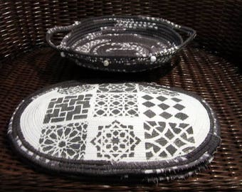 Charcoal gray corded and beaded basket with 4 stenciled and painted placemats.
