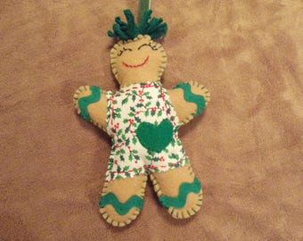 Felt gingerbread man with green trim and holiday apron