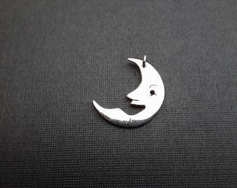 This hand made solid silver moon was designed and made by myself here in Birmingham.