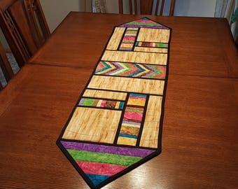 Multicolored/woodgrain Table Runner, 56 in x 14in
