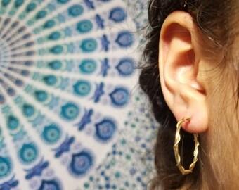 Solid 14k gold earrings .