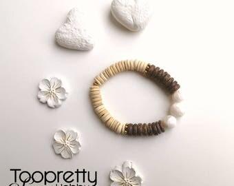 Stretch coconut wood bracelet with polymer clay