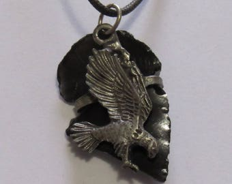 "Black Obsidian Arrowhead with an Eagle charm on a Knotted Cord, 1 5/8"" in length & 1"" in width.  Cord is 24"" long."