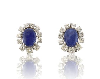 A large pair of blue sapphire and diamond cluster earrings in 18ct white gold