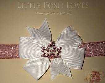 Rhinestone Tiara on Bow Headband that will look great on any girl from newborn and up. Special Occasions or Wear it Just Because
